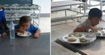 นักเรียนใช้มือกินข้าว